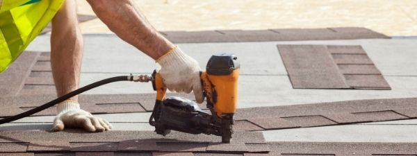 shingle installation professional performing replacement in lancaster pa